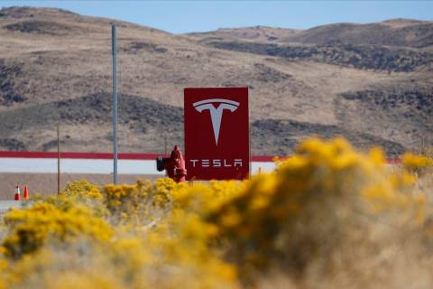 In this Oct. 13, 2018, file photo, a sign marks the entrance to the Tesla Gigafactory in Sparks ...