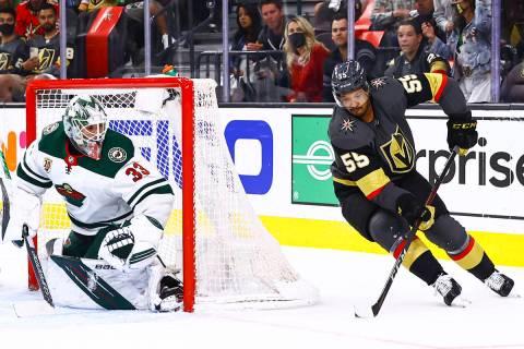Golden Knights' Keegan Kolesar (55) skates with the puck as Minnesota Wild goaltender Cam Talbo ...