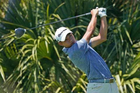 Collin Morikawa watches his tee shot on the second hole during the second round of the PGA Cham ...