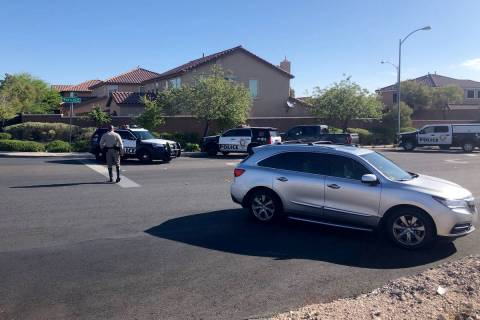 Police investigate an officer-involved shooting Saturday, May 22, 2021, on the 6200 block of Wi ...