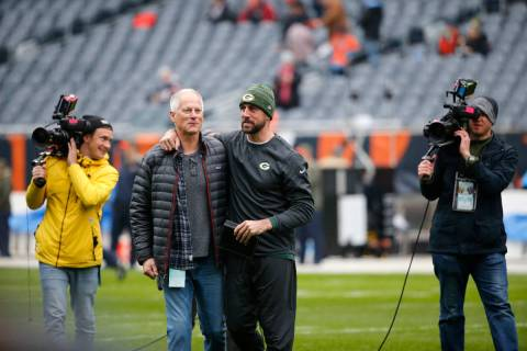Green Bay Packers' Aaron Rodgers, right, talk to ESPN's Kenny Mayne before an NFL football game ...