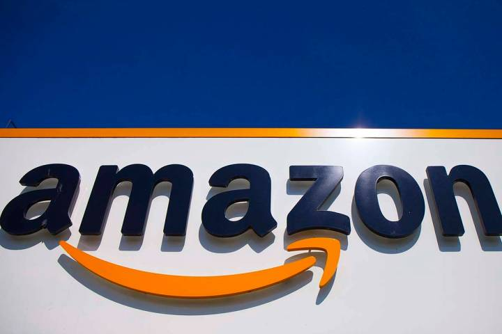 In this April 16, 2020, file photo, the Amazon logo is displayed in Douai, northern France. Am ...