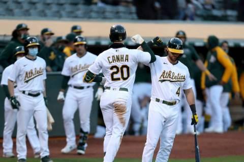 Oakland Athletics' Matt Chapman, left, celebrates with Matt Olson after the Athletics defeated ...