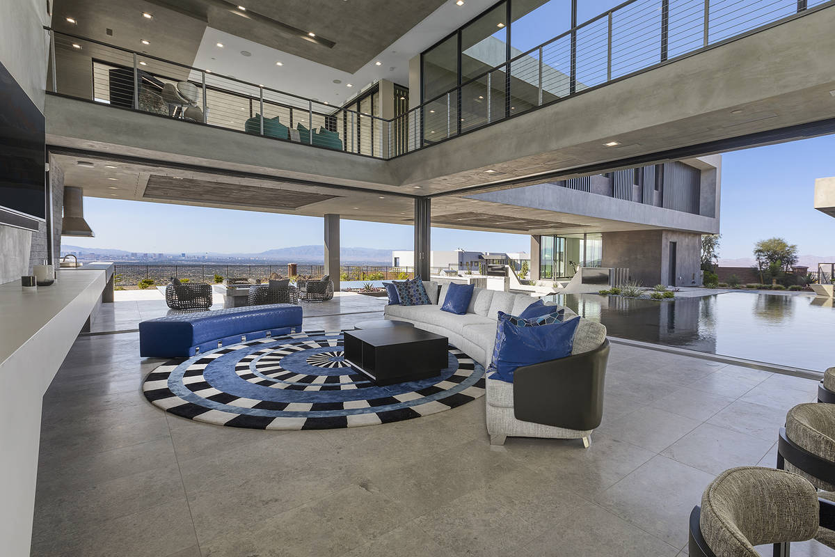 The living room opens to the pool. (Synergy Sotheby's International Realty)