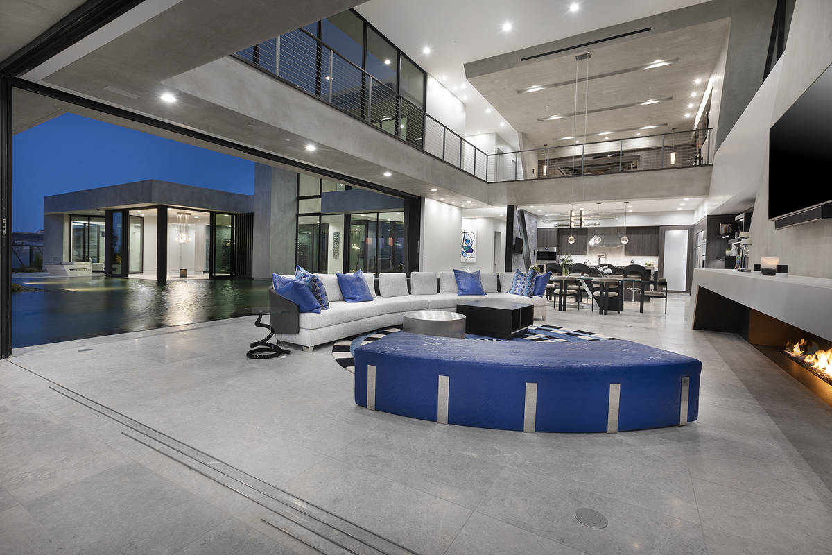 The home uses splashes of bright color in the modern design. (Synergy Sotheby's International ...