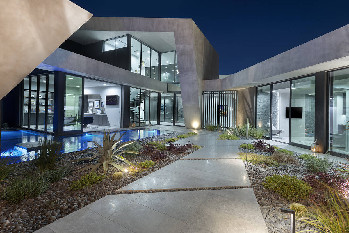 The Blue Heron-designed home has five en suite bedrooms, including a private upper-level master ...