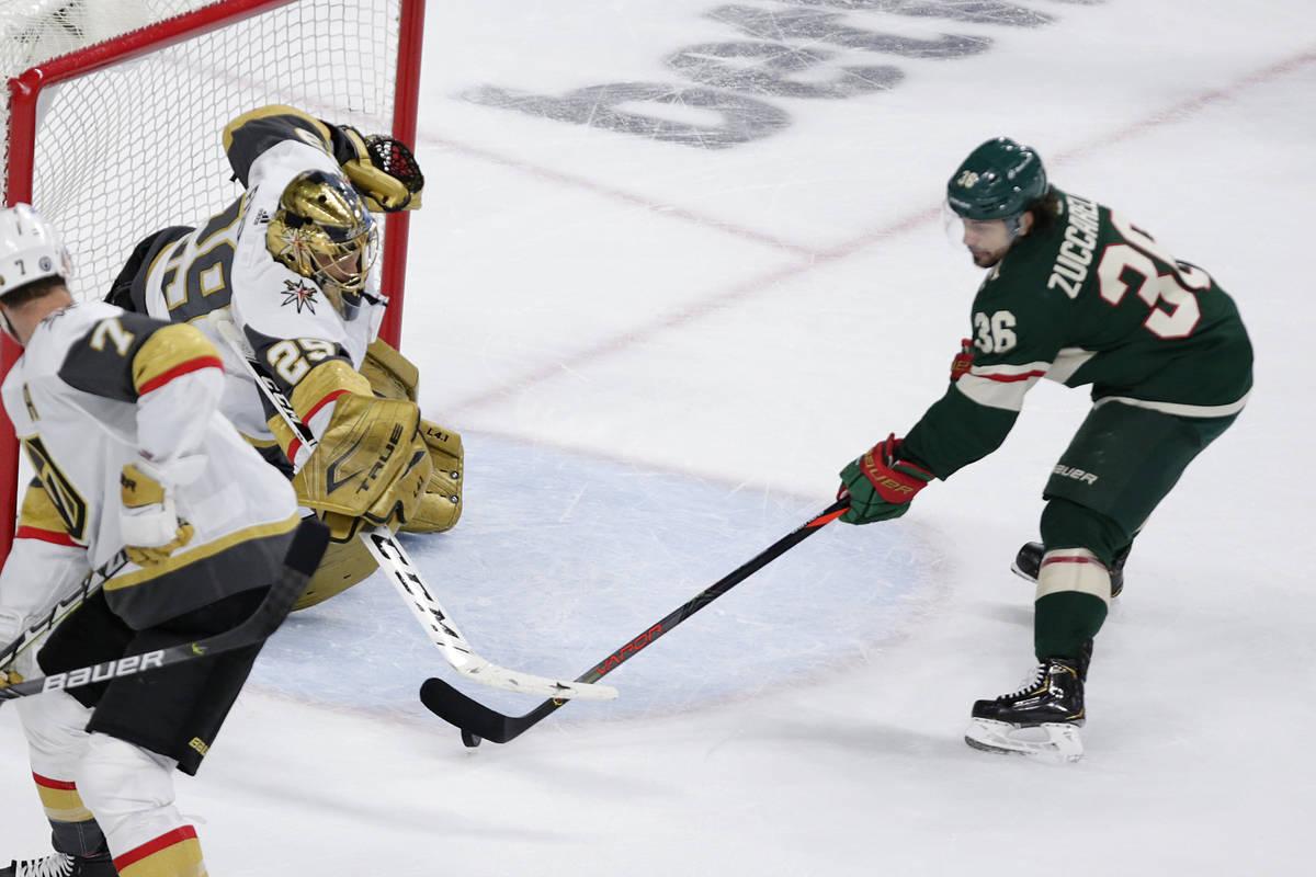 Vegas Golden Knights goaltender Marc-Andre Fleury (29) stops a shot by Minnesota Wild right win ...