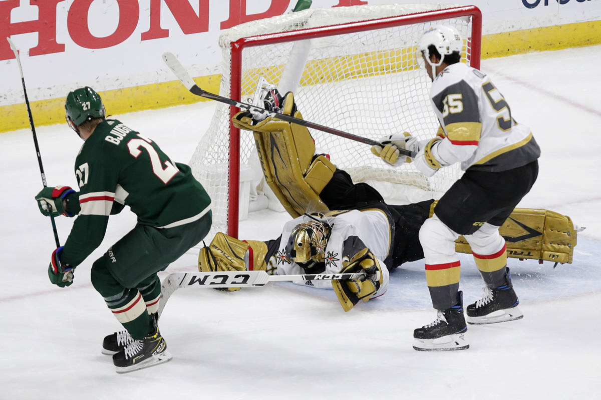 Minnesota Wild center Nick Bjugstad (27) scores a goal on Vegas Golden Knights goaltender Marc- ...