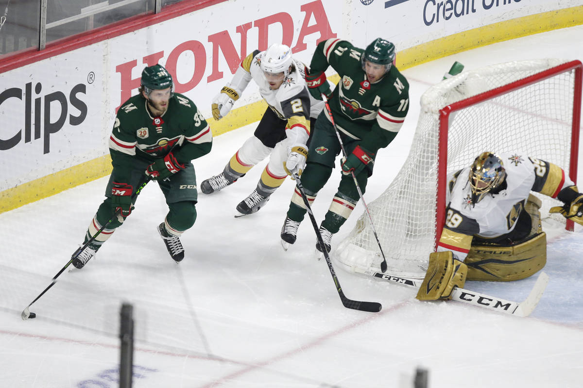 Minnesota Wild right wing Ryan Hartman (38) controls the puck in front of Vegas Golden Knights ...