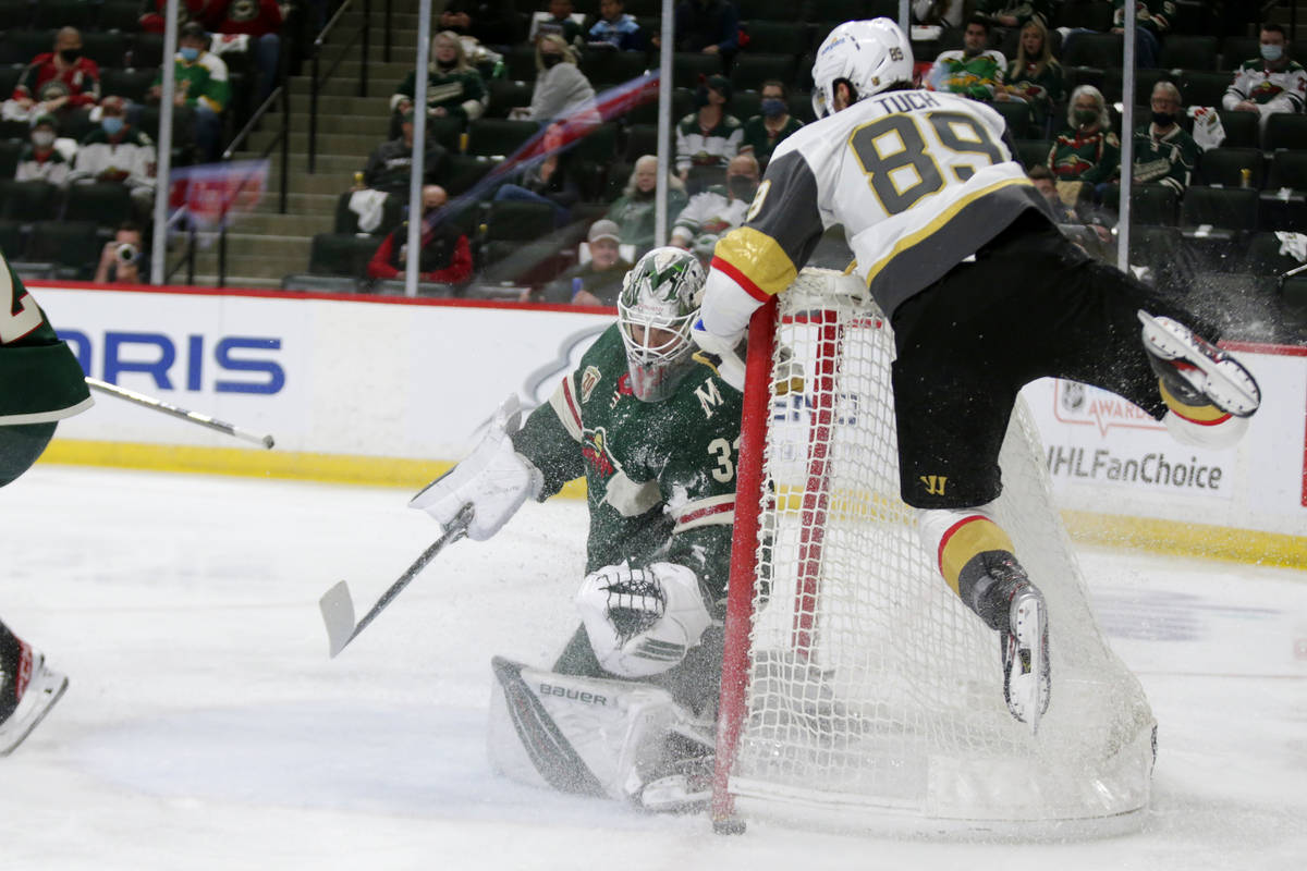 Minnesota Wild goaltender Cam Talbot (33) stops a shot by Vegas Golden Knights right wing Alex ...
