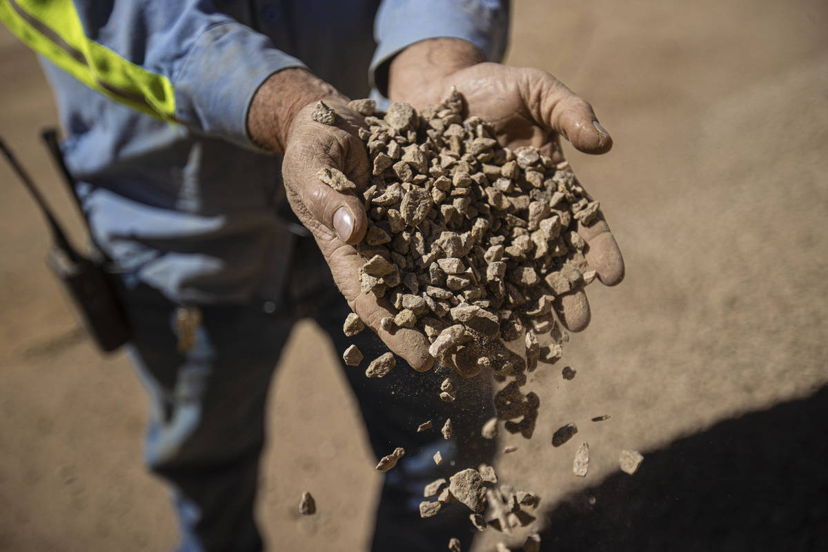 Robby Ruesch, manager of mining and delivery for Las Vegas-based company MP Materials, inspects ...