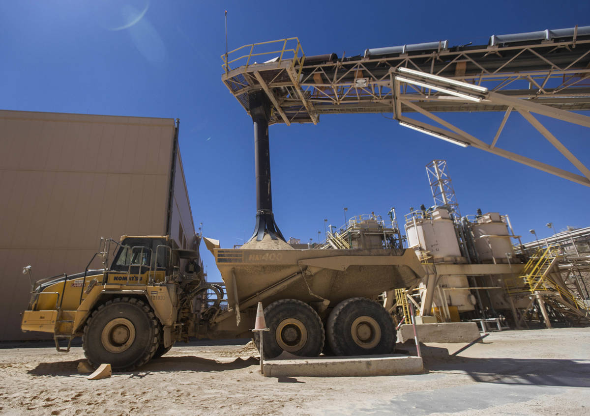 Rare earth concentrate pours onto a truck at Las Vegas-based company MP Materials on Thursday, ...