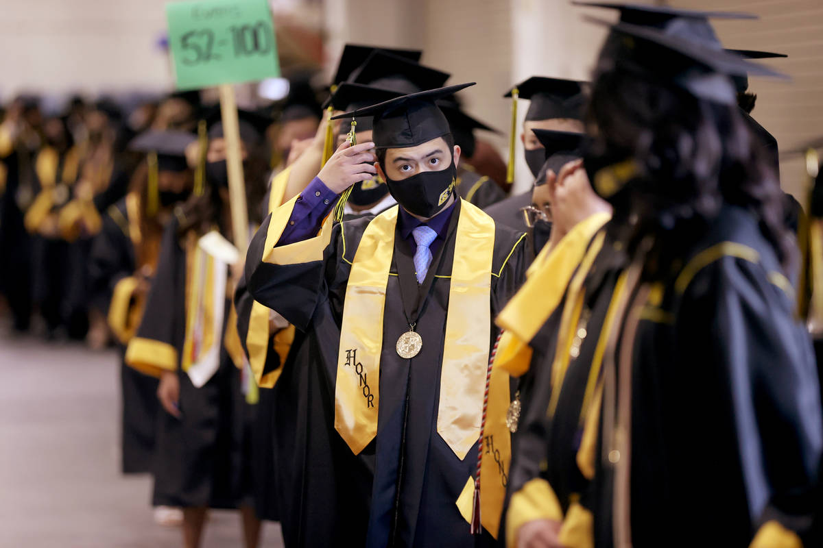 Clark High School student Jeremy Besitula prepares for his graduation ceremony at the Orleans A ...