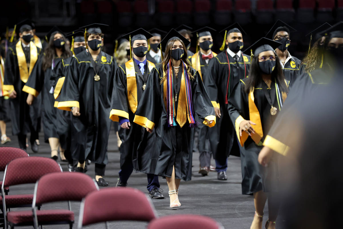 Clark High School students, including Sofia Bermudez, center, file in during a graduation cerem ...