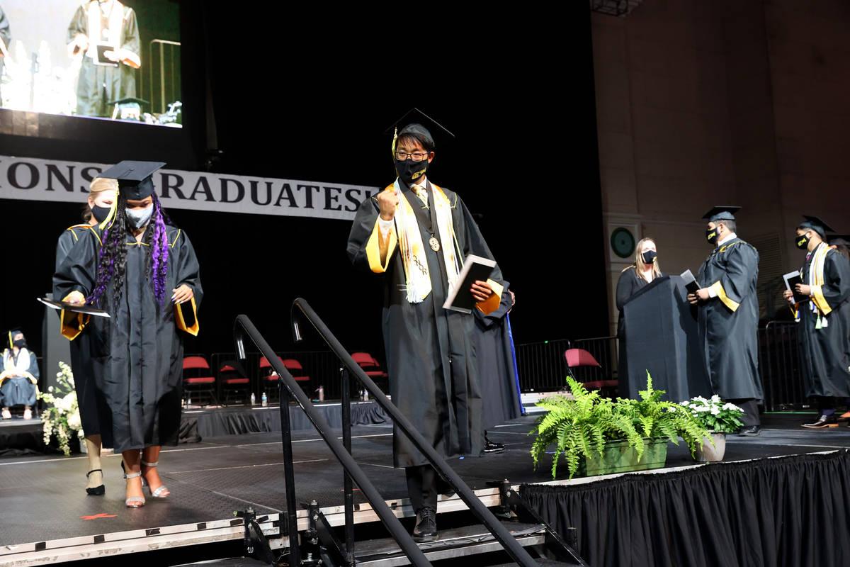 Clark High School student Jonathan Kwok celebrates after receiving his diploma during a graduat ...