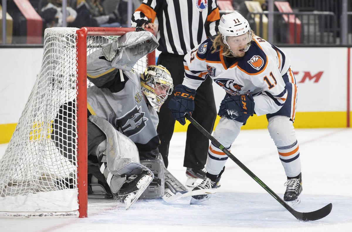 Henderson Silver Knights goaltender Logan Thompson (36) collides with Bakersfield Condors left ...