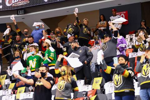 Golden Knights fans cheer before the start of Game 5 of a first-round NHL hockey playoff series ...