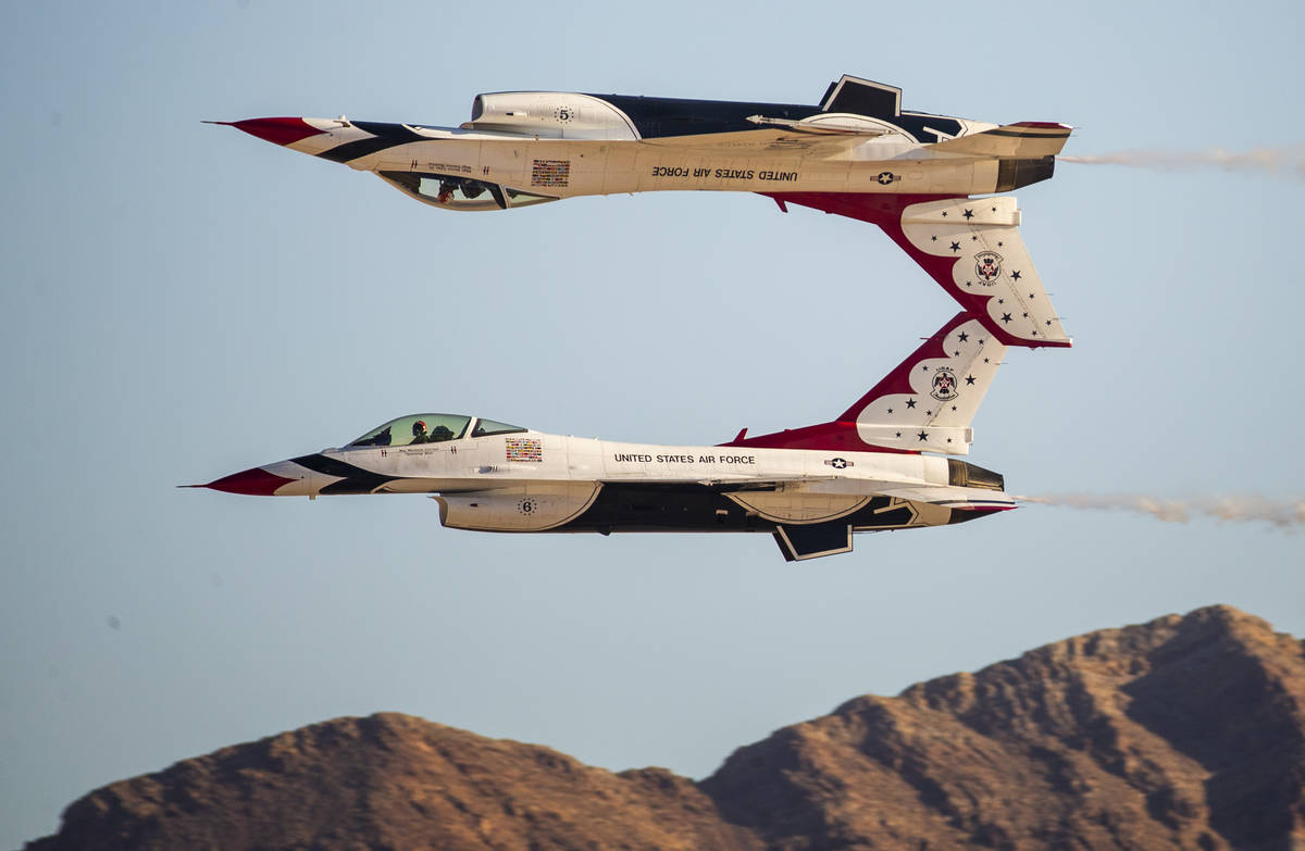 The U.S. Air Force Thunderbirds, with one inverted, in their performance during the Aviation Na ...