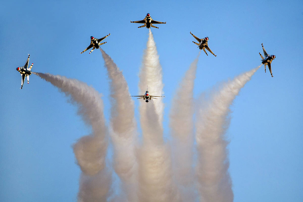 All six U.S. Air Force Thunderbirds break away from formation in various directions during the ...