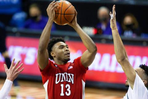 UNLV Rebels guard Bryce Hamilton (13) shoots over Utah State Aggies guard Marco Anthony (44) in ...