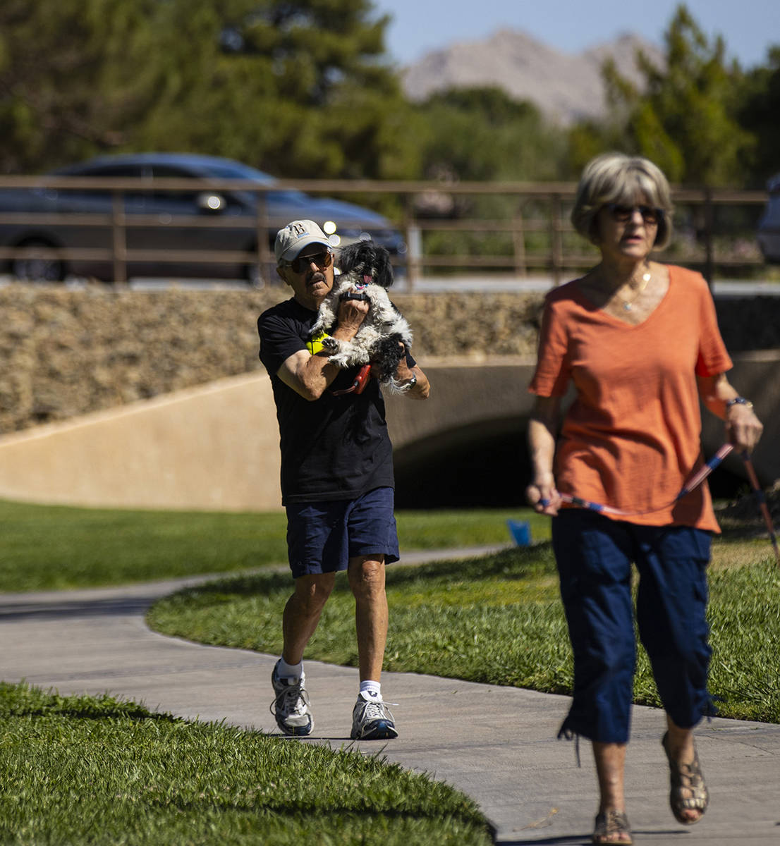 Phil Sardo carries his dog, Mei Mei, in Sun City Summerlin on Friday, May 28, 2021. (Chase Stev ...