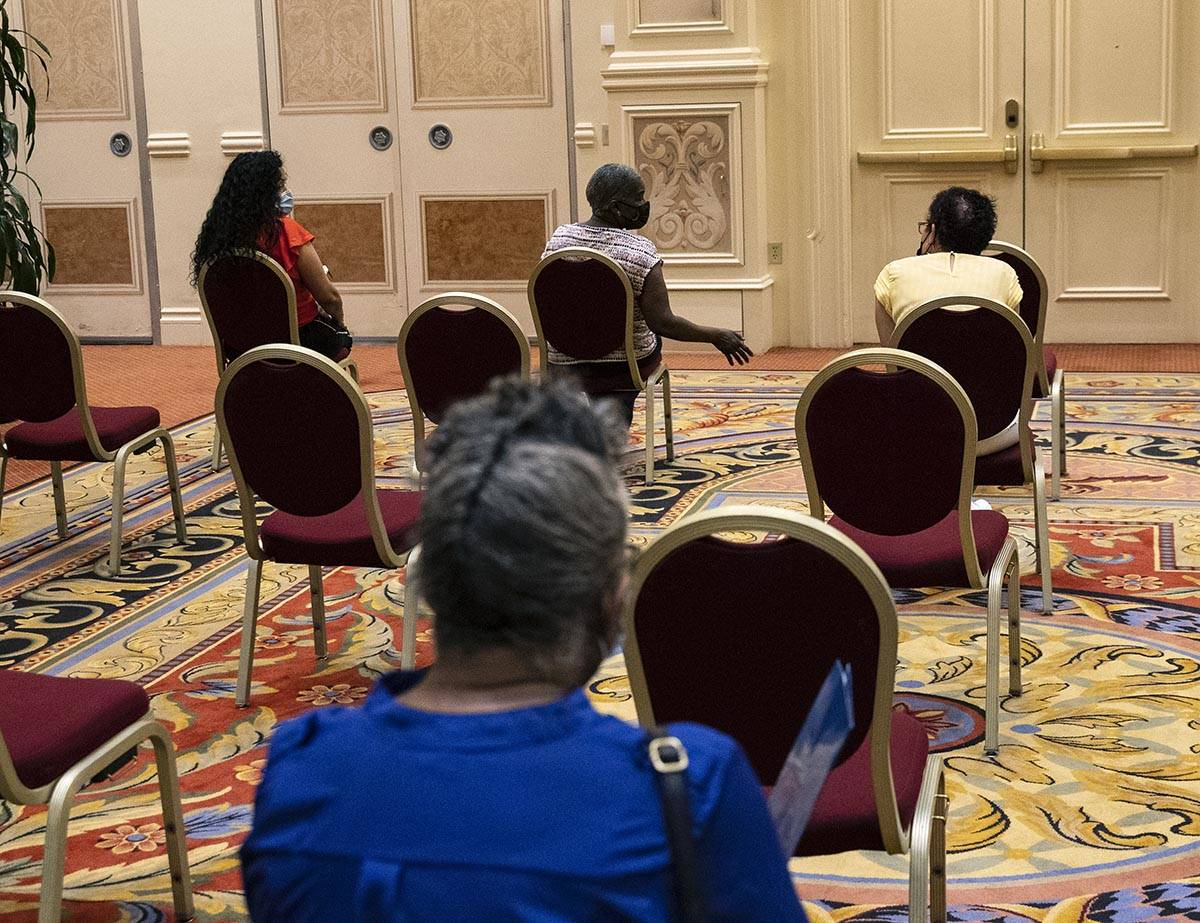 Jobs seekers wait after filling out their jobs applications during the Venetian hotel-casino ca ...