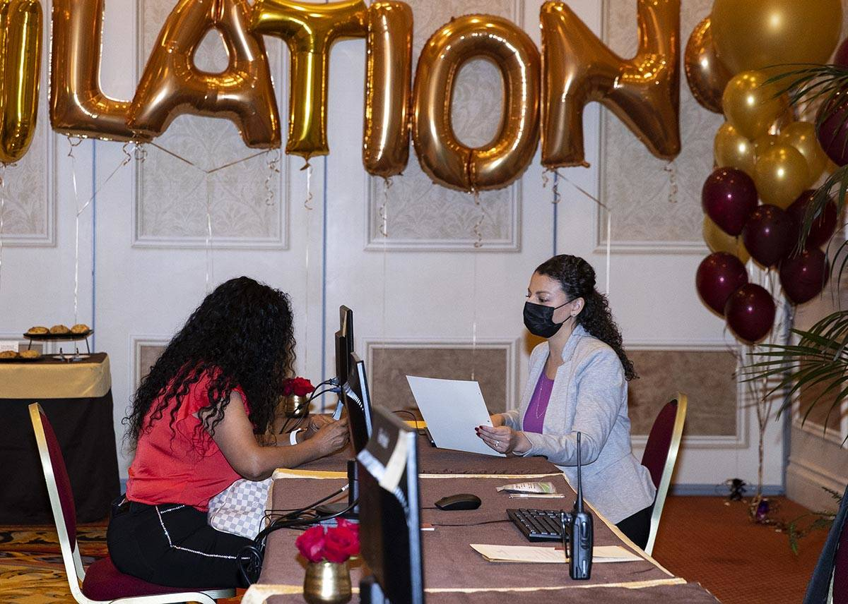 A newly hired employee discusses with Laura Hermosillo, right, a talent acquisition for the Ven ...