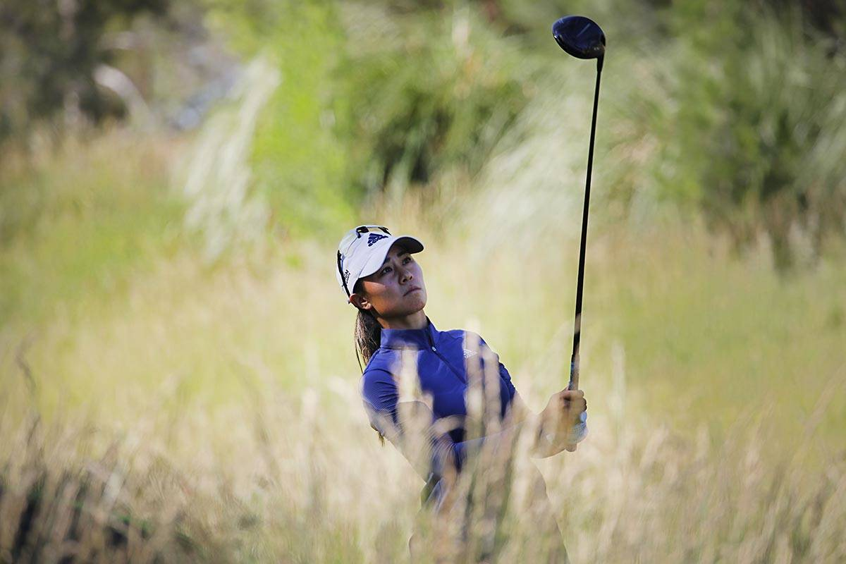 Danielle Kang of USA watches her tee shot on the 14th hole during the third round of the Bank o ...
