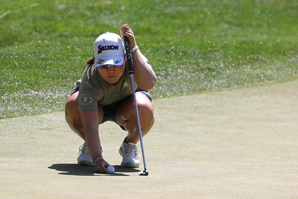 Nasa Hataoka of Japan places a ball on the first green during the third round of the Bank of Ho ...