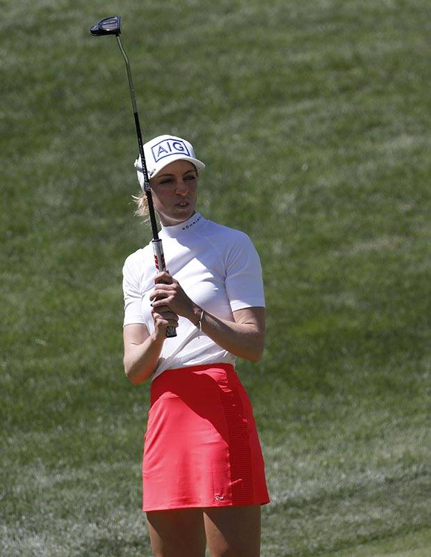 Sophia Popov of Germany reacts after her putt on the second green during the third round of th ...