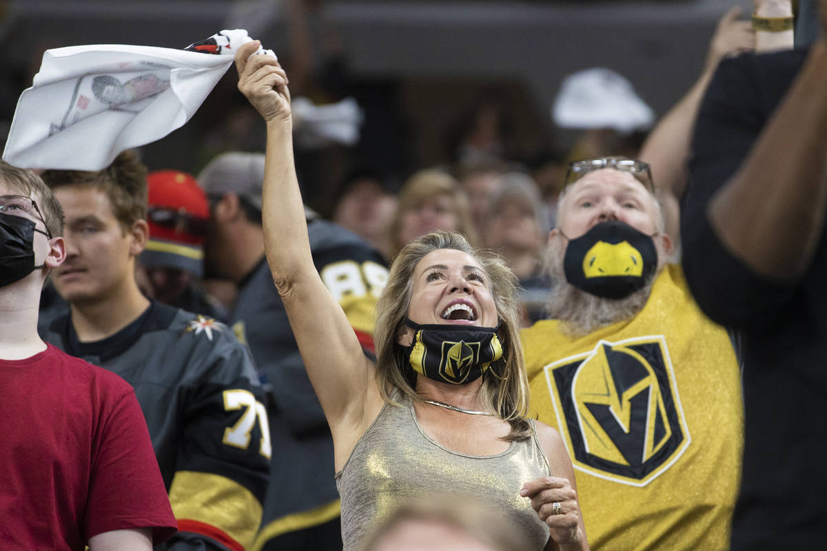 Golden Knights fans cheer for Vegas during Game 7 of the an NHL Stanley Cup first-round playoff ...