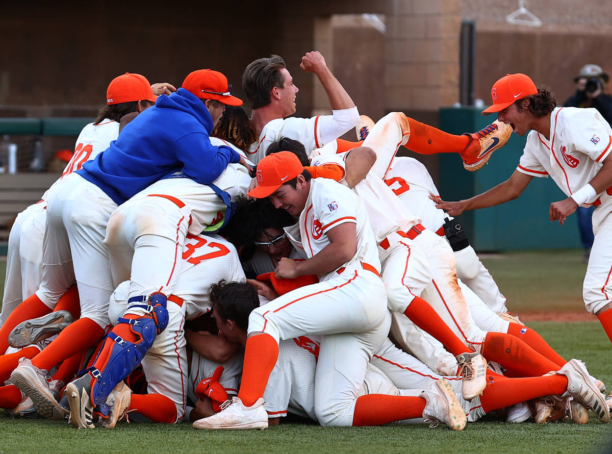 Bishop Gorman High School players celebrate their victory against Palo Verde in the Class 5A re ...