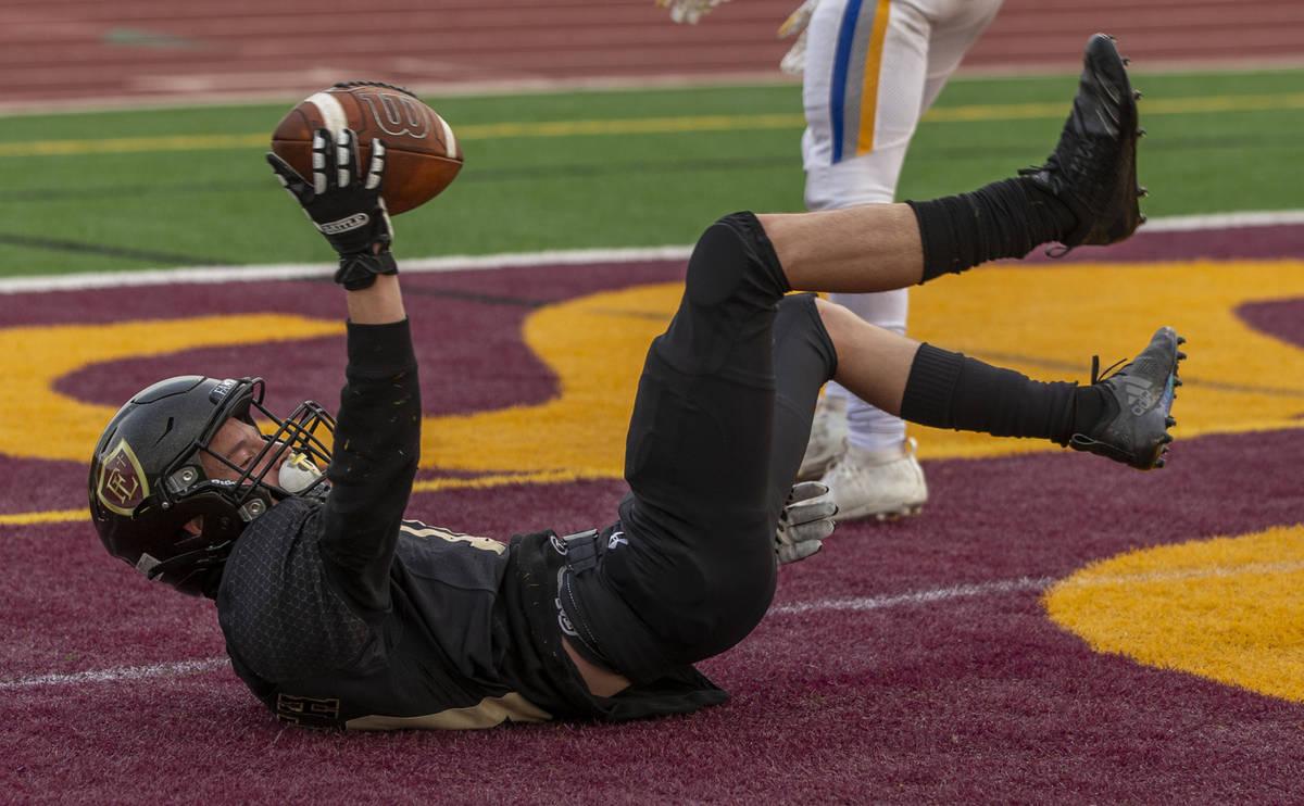 Faith LutheranÕs Landon Wrzesinski (10) celebrates a touchdown catch over Moapa Valley dur ...
