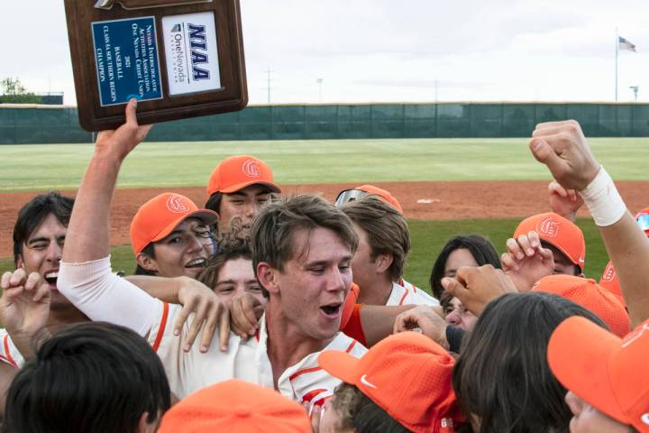 Bishop Gorman HighÕs right fielder Tyler Whitaker joins his teammates as they celebrate th ...