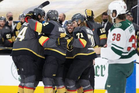 Vegas Golden Knights players celebrate after a second-period goal in game 7 of the an NHL Stanl ...