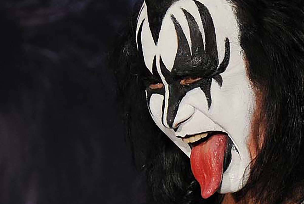 Gene Simmons poses for pictures at Motley Crue and Kiss the 2012 Mega Tour news conference, Tue ...