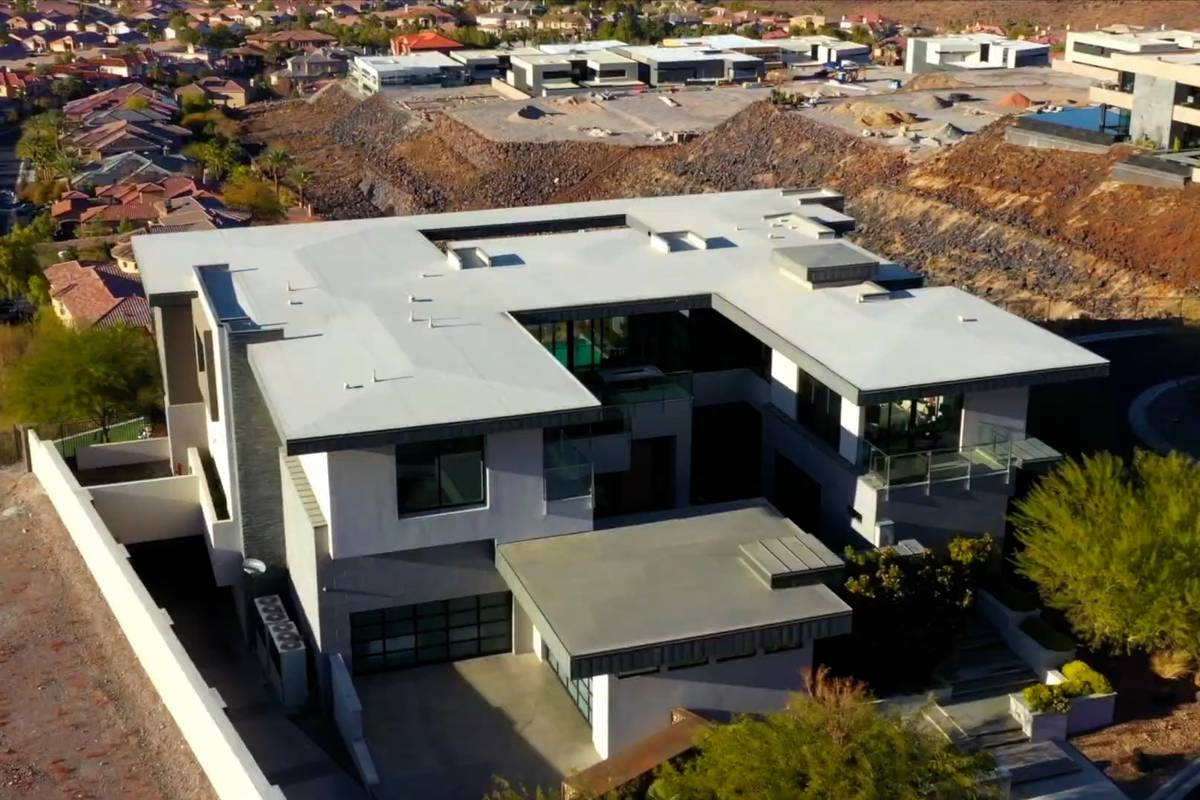 Rock star Gene Simmons of Kiss has paid a combined $10.8 million for a home in the Henderson hi ...