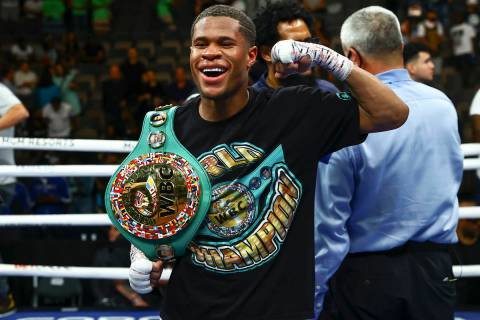 Devin Haney celebrates after defeating Jorge Linares by unanimous decision in the WBC lightweig ...