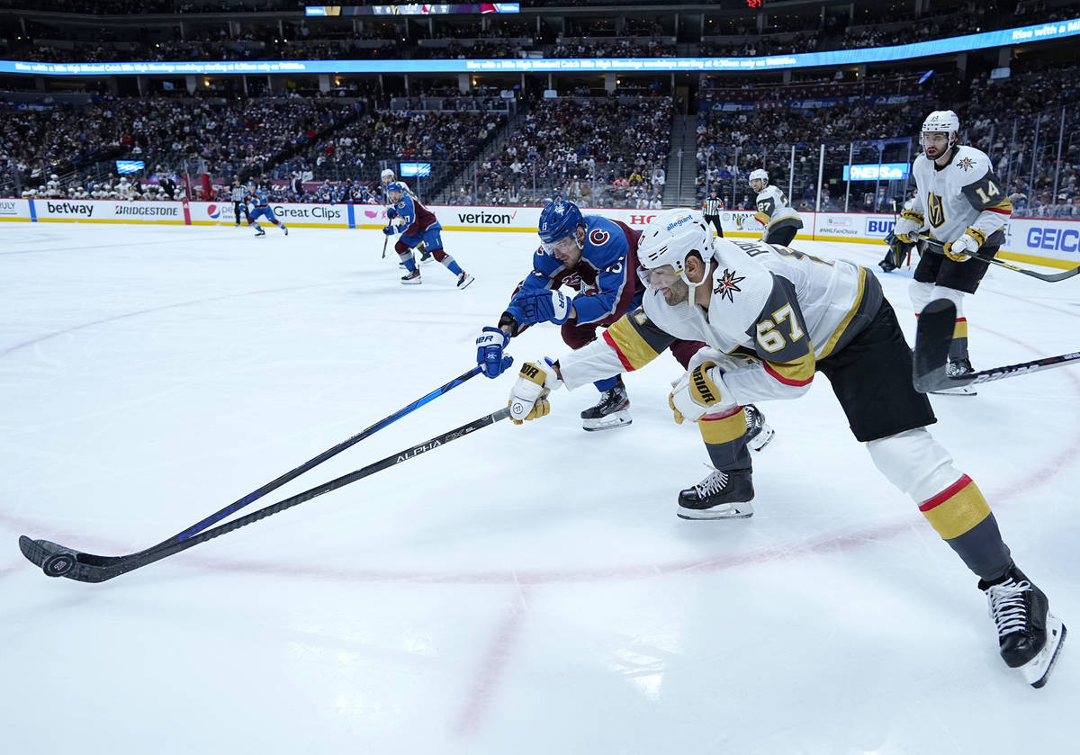 Colorado Avalanche right wing Valeri Nichushkin (13) and Vegas Golden Knights left wing Max Pac ...