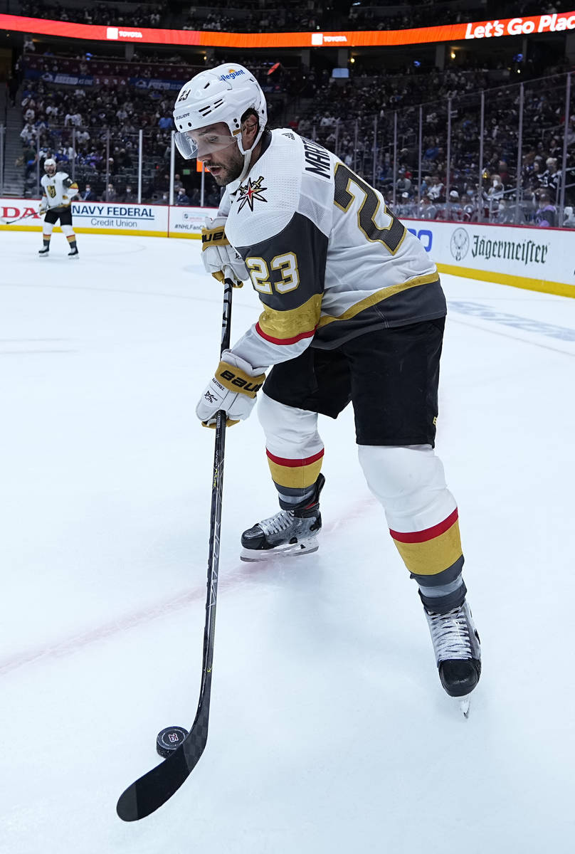 Vegas Golden Knights defenseman Alec Martinez (23) moves the puck against the Colorado Avalanch ...