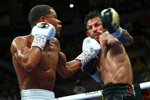 Devin Haney, left, punches Jorge Linares during the WBC lightweight title boxing match Saturday ...