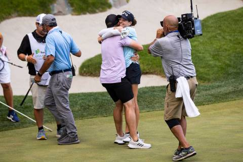Ally Ewing celebrates with her husband, Charlie Ewing, after winning the championship round of ...
