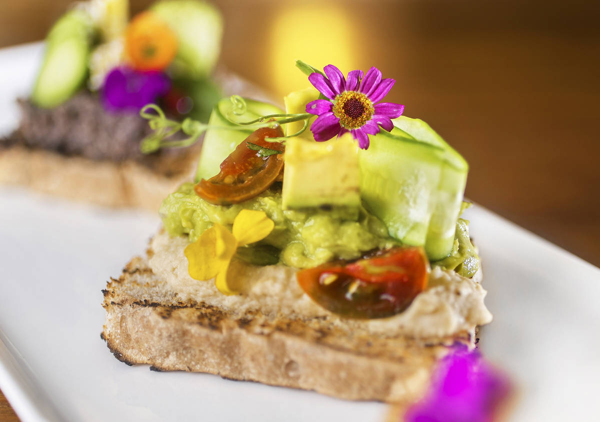 Truth & Tonic's cauliflower hummus and avocado toast with melted petite heirloom tomatoes, av ...