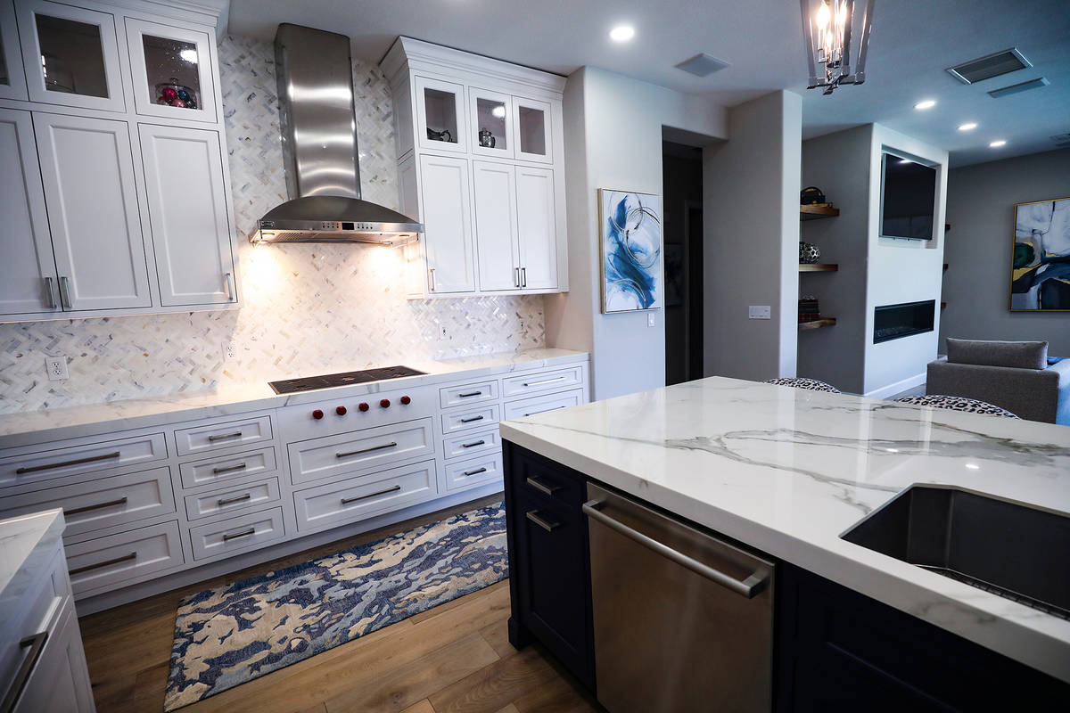 Use lightly veined quartz for counters paired with a pearly backsplash. (Rachel Aston)