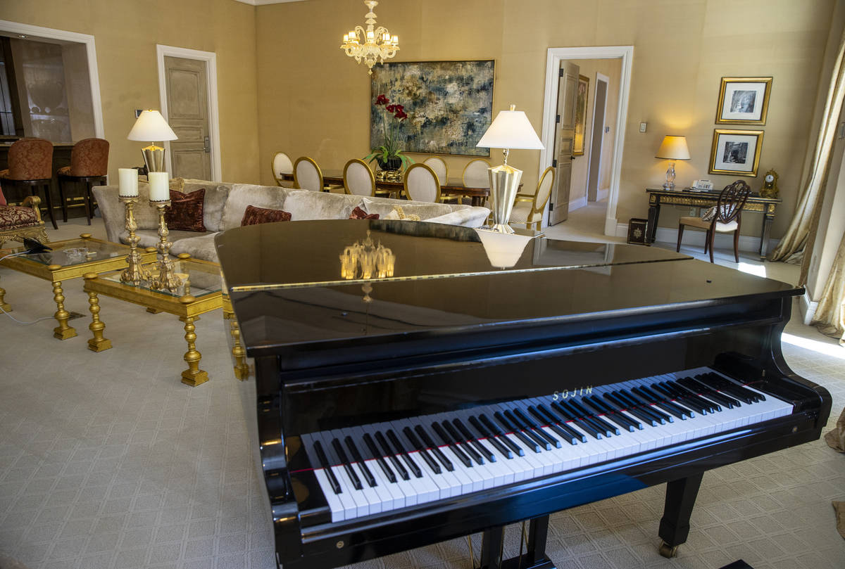 A piano is one of the amenities within one of the Palazzo Suites during a tour of the Rio with ...