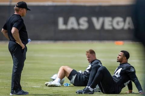 Head Coach Jon Gruden talks with safety Johnathan Abram (24) during a Las Vegas Raiders open pr ...
