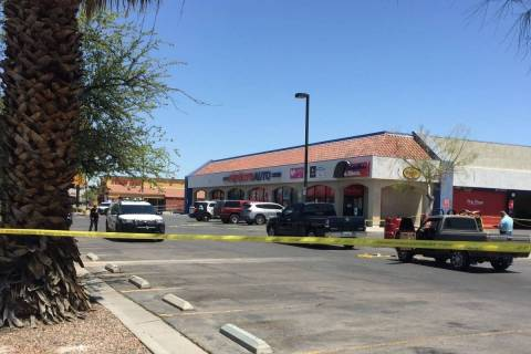 Las Vegas police investigate the scene of a homicide in the 3900 block of East Charleston Boule ...