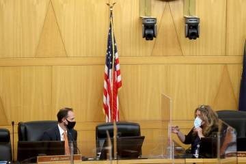 Clark County commissioners Justin Jones, left, and Chairman Marilyn Kirkpatrick talk before a c ...