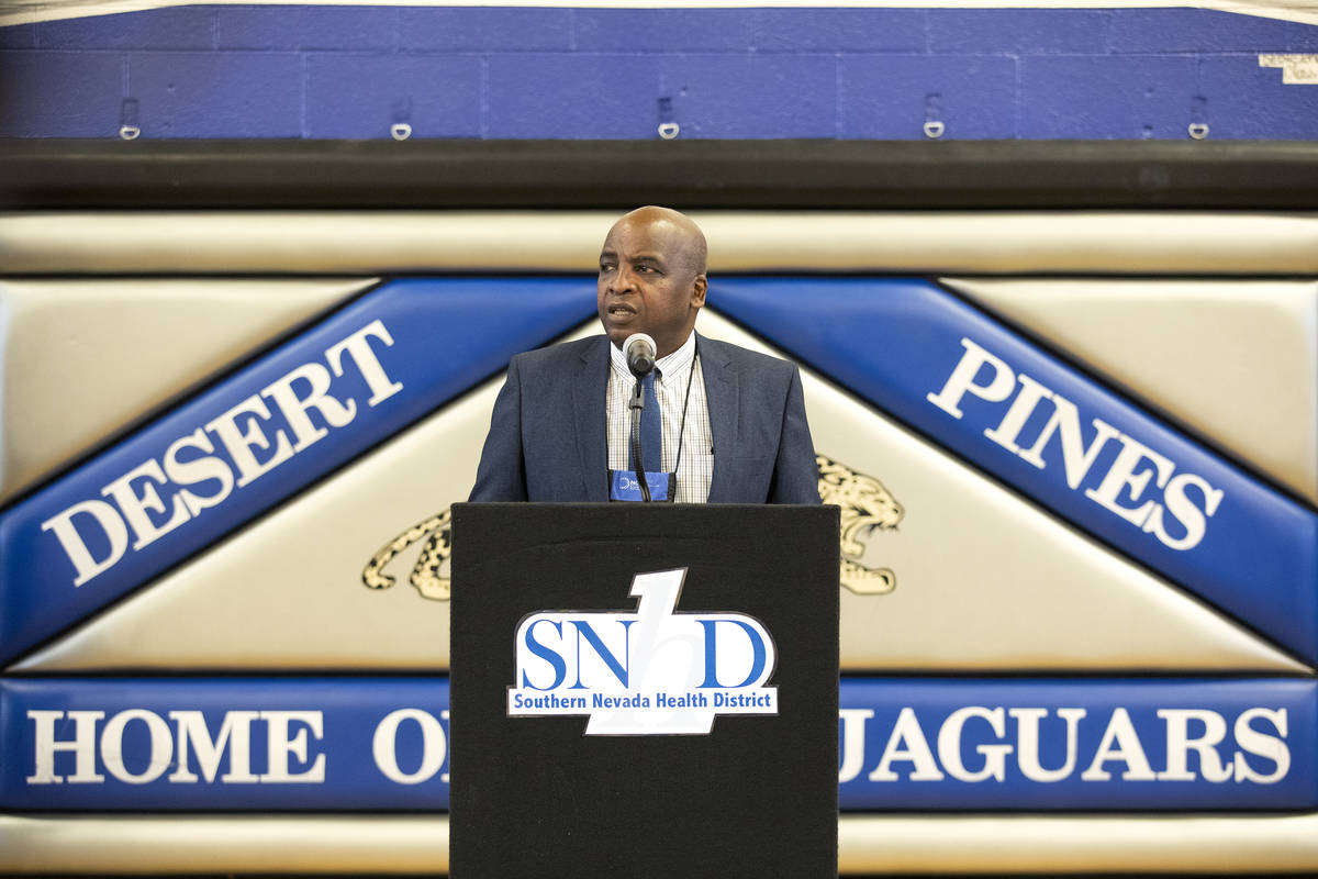 Dr. Fermin Leguen, district health officer of the Southern Nevada Health district, speaks to th ...