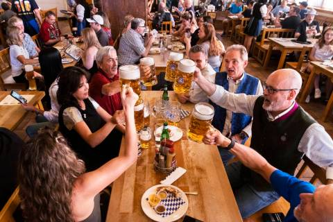 Guests raise their beer mugs for a cheers during the grand reopening of Hofbrauhaus Las Vegas o ...
